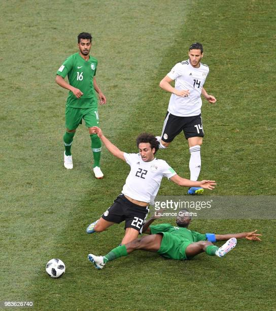 Osama Hawsawi of Saudi Arabia tackles Amr Warda of Egypt during the 2018 FIFA World Cup Russia group A match between Saudia Arabia and Egypt at...