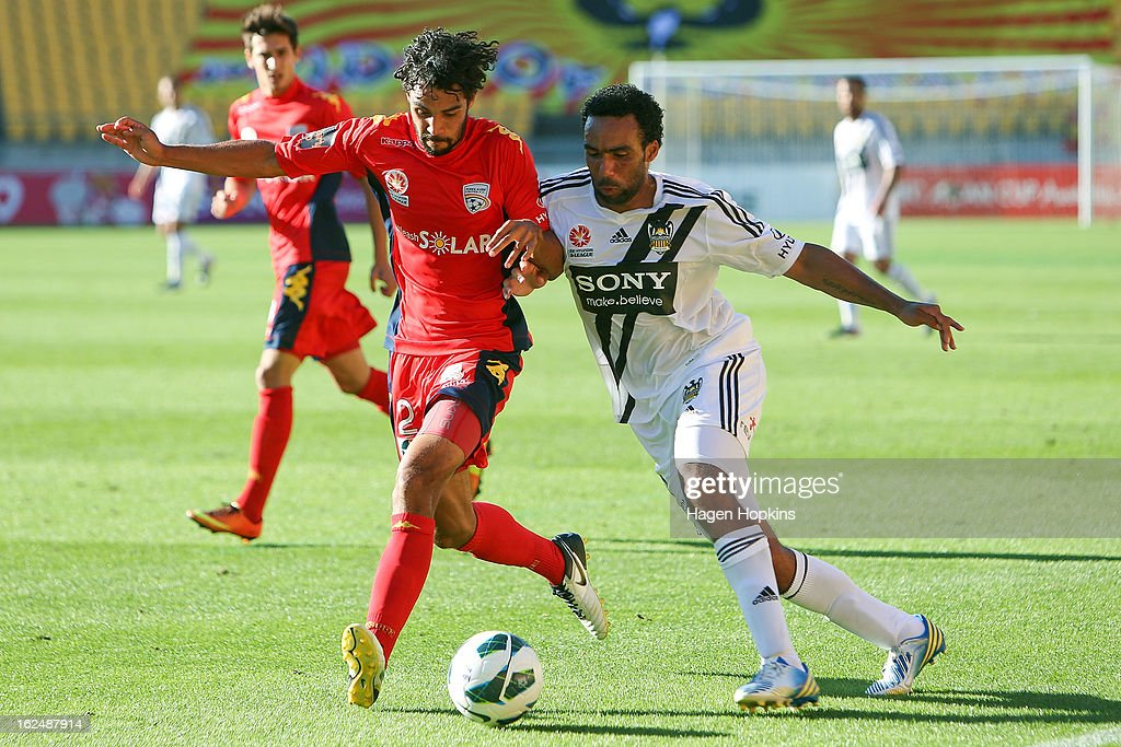 Osama Malik of Adelaide and Paul Ifill of the Phoenix compete for the ball during the round 22 A-League match between the Wellington Phoenix and Adelaide United at Westpac Stadium on February 24, 2013 in Wellington, New Zealand.