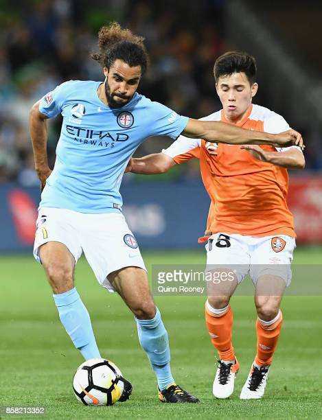 Osama Malik of the City and Joe Caletti of the Roar compete for the ball during the round one ALeague match between Melbourne City FC and the...
