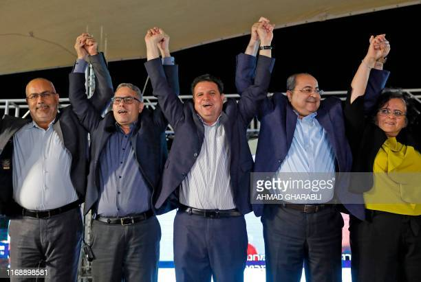 Osama Saadi member and candidate for the Arab Movement for Change party that is part of the Joint List alliance raises his hands together with Balad...