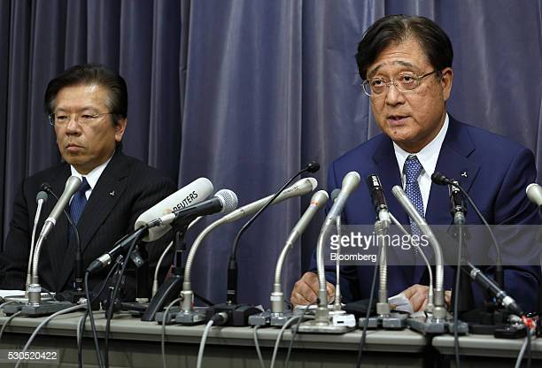 Osamu Makuko chairman and chief executive officer of Mitsubishi Motors Corp right speaks as Tetsuro Aikawa president and chief operating officer of...