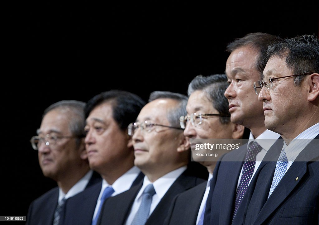 Osamu Masuko, president of Mitsubishi Motors Corp., from second left, Takashi Yamanouchi, chief executive officer of Mazda Motor Corp., Toshiyuki Shiga, chief operating officer of Nissan Motor Co., Takanobu Ito, chief executive officer of Honda Motor Co., and Akio Toyoda, president of Toyota Motor Corp., pose before a joint news conference hosted by the Japan Automobile Manufacturers Association Inc. (JAMA) in Tokyo, Japan, on Monday, Oct. 29, 2012. Toyota and other Japanese carmakers reiterated their call for the government to scrap vehicle taxes to spur domestic demand. Photographer: Tomohiro Ohsumi/Bloomberg via Getty Images