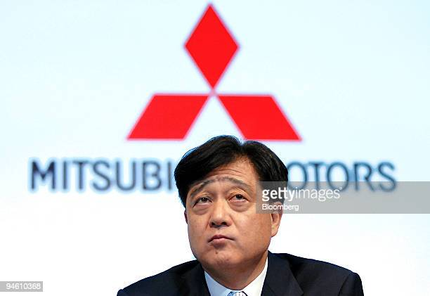 Osamu Masuko president of Mitsubishi Motors Corp listens to a question from the floor during news event to unveil the automaker's Lancer Evolution X...