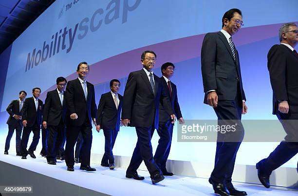 Osamu Masuko president of Mitsubishi Motors Corp third from left Toshiyuki Shiga vice chairman of Nissan Motor Co fourth from left Akio Toyoda...