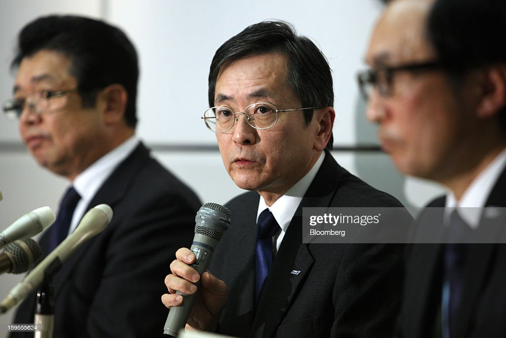 Osamu Shinobe, executive vice president of All Nippon Airways Co. (ANA), center, speaks during a news conference in Tokyo, Japan, on Wednesday, Jan. 16, 2013. ANA and Japan Airlines Co. (JAL), the world's largest users of Boeing Co. 787 jets, grounded their entire fleet of Dreamliners for today in the biggest blow yet to the troubled passenger jet's image. Photographer: Tomohiro Ohsumi/Bloomberg via Getty Images