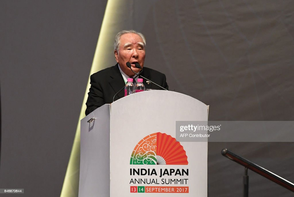 Osamu Suzuki,Japanese businessman and current Chairman of Suzuki Motor Corporation speaks at the India-Japan Buissness Plenary session during the India-Japan Annual summit at Mahatama Mandir convention center in Gandhinagar on September 14, 2017. Japan's Prime Minister Shinzo Abe on September 14 inaugurated India's first bullet train project -- a $19 billion line in the home state of Indian leader Narendra Modi intended to revitalise the country's vast but dilapidated network. /