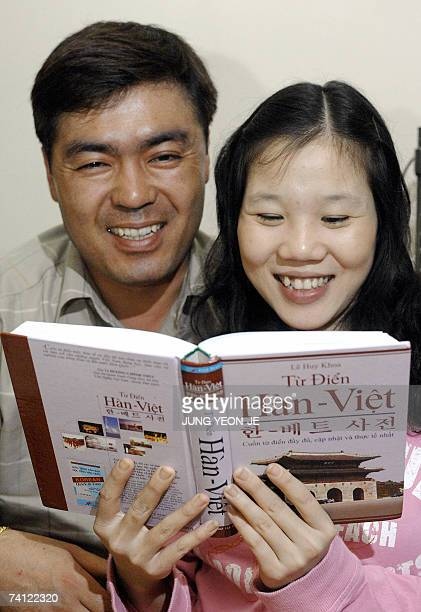 TO GO WITH LIFESTYLESKOREAASIAMARRIAGES by Park ChanKyong Kim ChoongHwan a 40yearold South Korean truck driver and his Vietnamese wife Ngo Ngoc Quy...