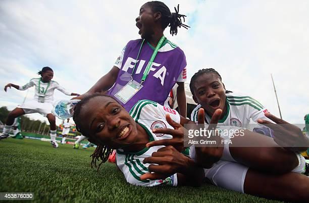 Osarenoma Igbinovia and Gladys Abasi of Nigeria celebrate after the FIFA U20 Women's World Cup Canada 2014 Semi Final match between Korea DPR and...