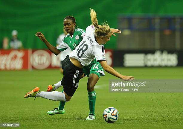 Osarenoma Igbinovia of Nigeria and Lena Petermann of Germany battle for the ball during the FIFA U20 Women's World Cup 2014 final match between...