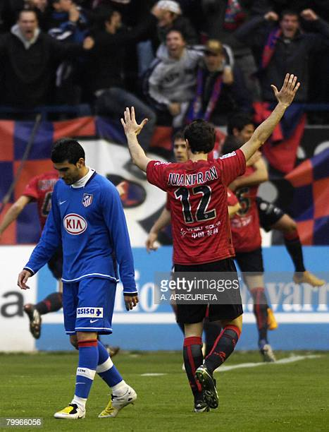 Osasuna players celebrate scoring their second goal against Atletico de Madrid during a Spanish league football match on February 24 2008 at the...