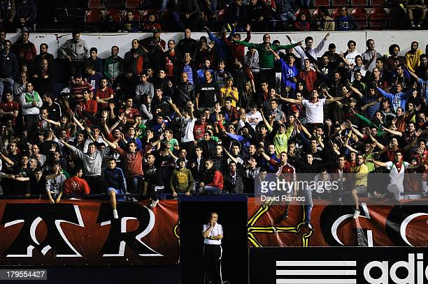 Osasuna supporters cheer his team up during the La Liga match between CA Osasuna and Villareal CF at El Sadar Stadium on August 31 2013 in Pamplona...