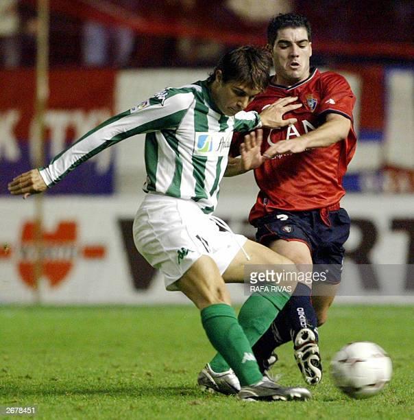 Osasuna's Antonio Lopez vies with Betis' Joaquin Sanchez 29 October 2003 during a Spanish soccer league match in the Sadar stadium in Pamplona RAFA...