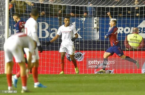 Osasuna's Argentinian forward Chimy Avila celebrates his goal during the Spanish league football match between CA Osasuna and Sevilla FC at El Sadar...