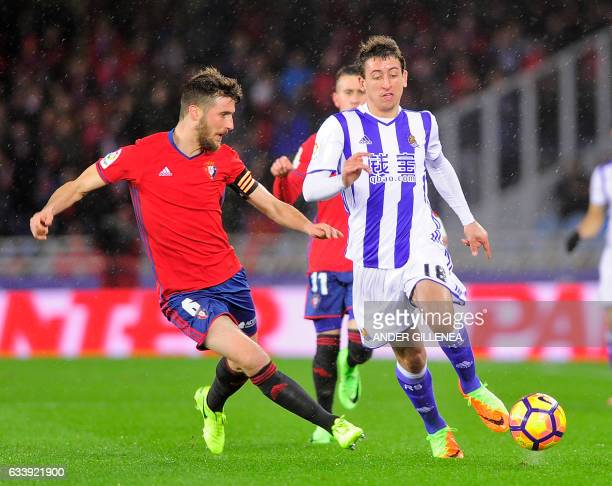 Osasuna's midfielder Oier Sanjurjo vies withReal Sociedad's forward Mikel Oyarzabal during the Spanish league football match Real Sociedad vs CA...