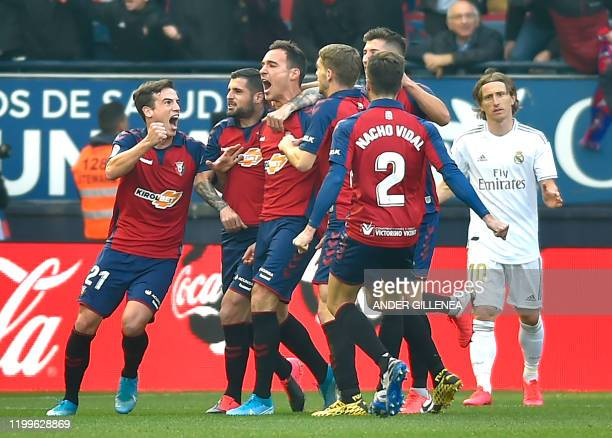 Osasuna's players celebrate their opening goal scored by Osasuna's Spanish defender Unai Garcia during the Spanish league football match between CA...