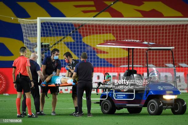 Osasuna's Serbian midfielder Darko Brasanac is carried on a stretcher after resulting injuried during the Spanish League football match between FC...