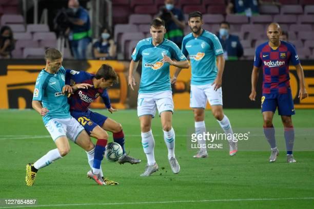 Osasuna's Serbian midfielder Darko Brasanac vies with Barcelona's Spanish midfielder Riqui Puig during the Spanish League football match between FC...