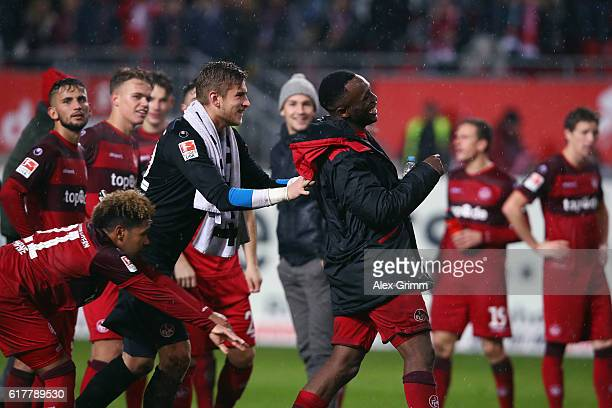 Osayamen Osawe goalkeeper Julian Pollersbeck and team mates of Kaiserslautern celebrate with the fans after the Second Bundesliga match between 1 FC...