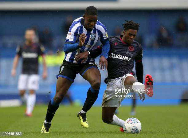Osaze Urhoghide of Sheffield Wednesday is challenged by Omar Richards of Reading FC ] during the Sky Bet Championship match between Sheffield...