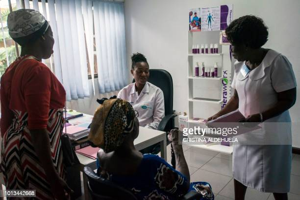 R Osazuwa dermatologist at Rabito Clinic in Accra takes care of a patient in her consulting room on July 3 2018 Africa is experiencing a massive...