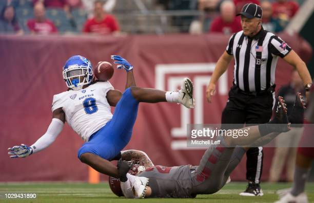 J Osborn of the Buffalo Bulls cannot make the catch against Rodney Williams of the Temple Owls in the first quarter at Lincoln Financial Field on...