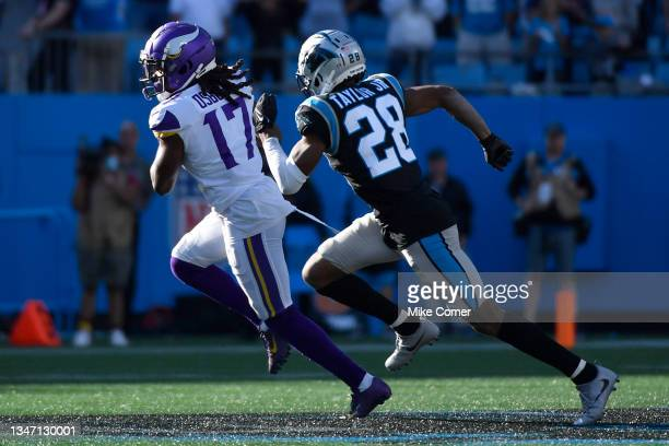 Osborn of the Minnesota Vikings runs with the ball against Keith Taylor Jr. #28 of the Carolina Panthers during the fourth quarter at Bank of America...