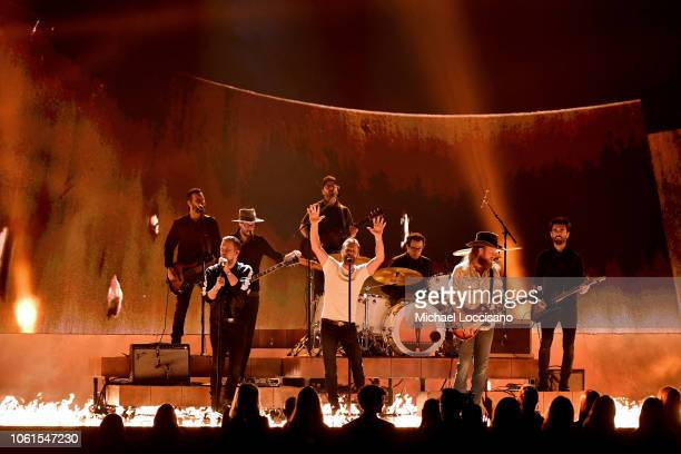 TJ Osborne and John Osborne of Brothers Osborne perform onstage with Dierks Bentley during the 52nd annual CMA Awards at the Bridgestone Arena on...
