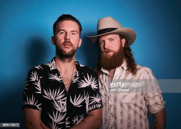 J Osborne and John Osborne of Brothers Osborne pose in the portrait studio at the 2018 CMA Music Festival at Nissan Stadium on June 7 2018 in...