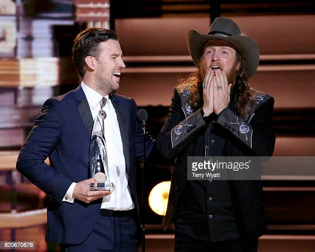 J Osborne and John Osborne of musical duo Brothers Osborne accept award onstage at the 50th annual CMA Awards at the Bridgestone Arena on November 2...