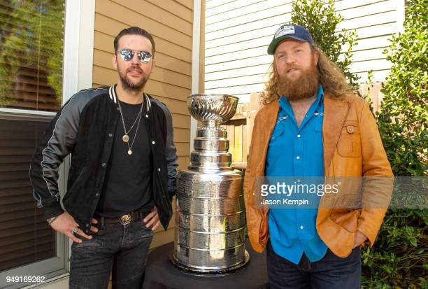 J Osborne and John Osborne of the band Brothers Osborne pose with the Stanley Cup Trophy at Q Prime Nashville on April 20 2018 in Nashville Tennessee