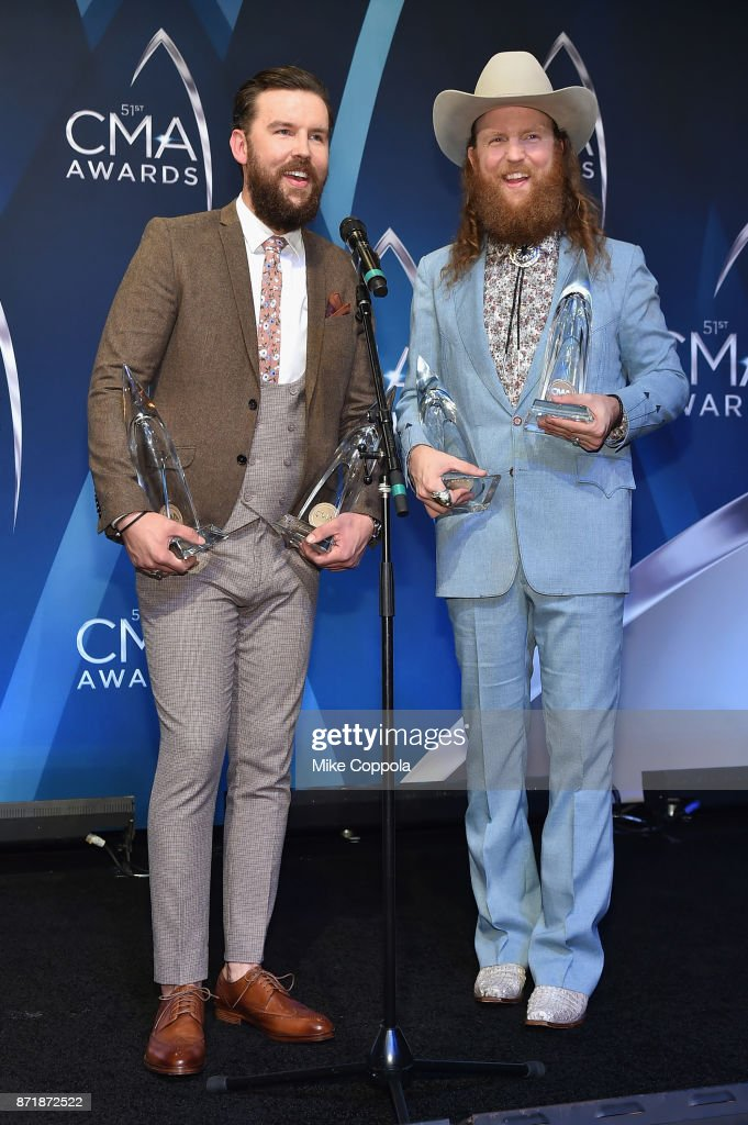 T.J. Osborne and John Osborne of the Brothers Osborne pose in the press room at the 51st annual CMA Awards at the Bridgestone Arena on November 8, 2017 in Nashville, Tennessee.
