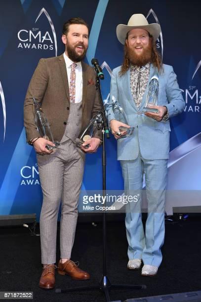 TJ Osborne and John Osborne of the Brothers Osborne pose in the press room at the 51st annual CMA Awards at the Bridgestone Arena on November 8 2017...