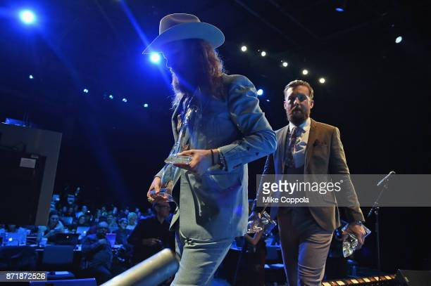 J Osborne and John Osborne of the Brothers Osborne pose in the press room at the 51st annual CMA Awards at the Bridgestone Arena on November 8 2017...