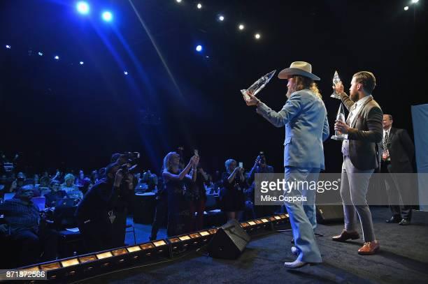 J Osborne and John Osborne of the Brothers Osborne pose in the press room at the 51st annual CMA Awards at the Bridgestone Arena on November 8 2017...