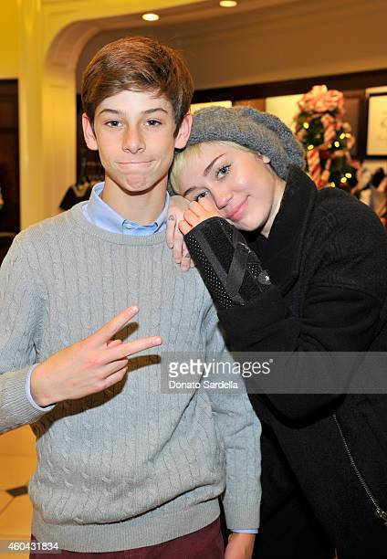 DJ Oscar Adler and singer Miley Cyrus attend as Brooks Brothers celebrates the holidays with St Jude Children's Research Hospital and Town Country at...