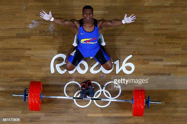 Oscar Albeiro Figueroa Mosquera of Colombia reacts during the Men's 62kg Group A weightlifting contest on Day 3 of the Rio 2016 Olympic Games at the...