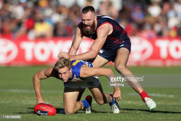 Oscar Allen of the Eagles is challenged by Max Gawn of the Demons during the round 18 AFL match between the Melbourne Demons and the West Coast...