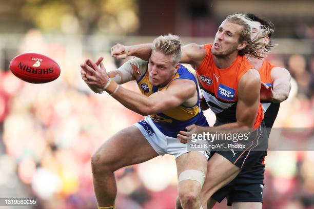 Oscar Allen of the Eagles is challenged by NickHaynes of the Giants during the round 10 AFL match between the Greater Western Sydney Giants and the...