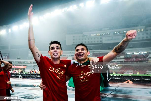 Oscar and Elkeson de Oliveira Cardoso of Shanghai SIPG celebrate after winning the Chinese Super League championship against Beijing Renhe during the...