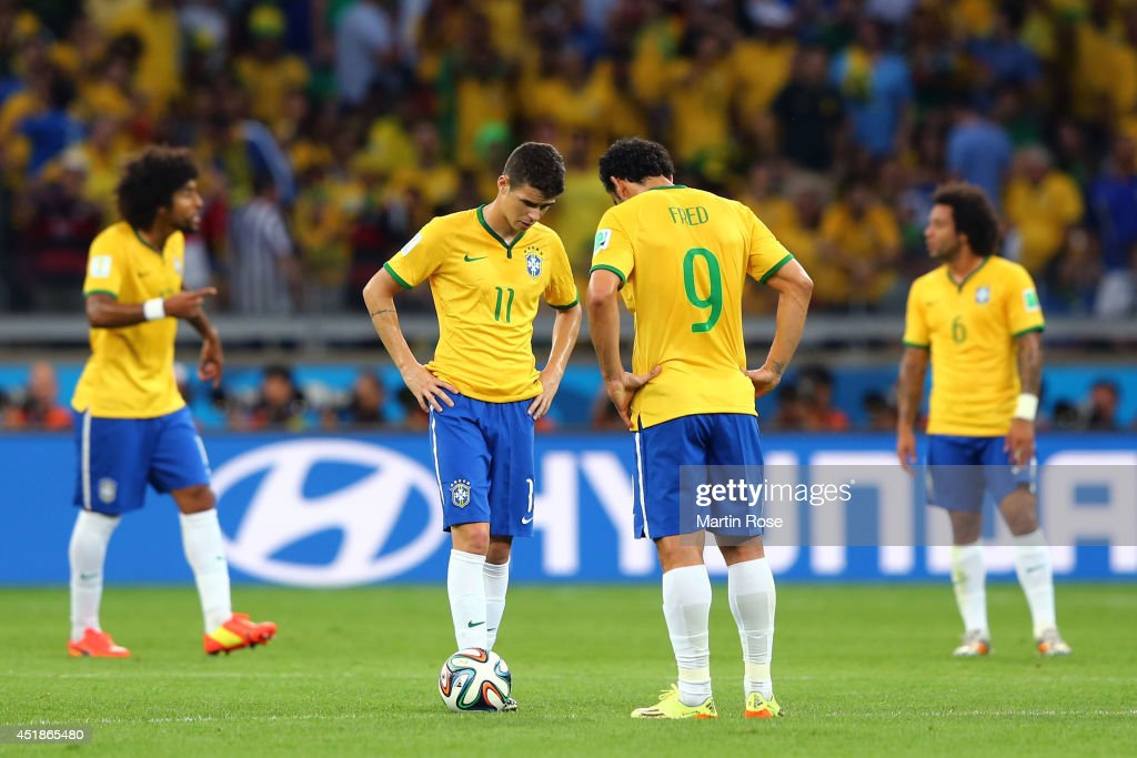 Oscar and Fred of Brazil prepare to kick off after a goal during the 2014 FIFA World Cup Brazil Semi Final match between Brazil and Germany at Estadio Mineirao on July 8, 2014 in Belo Horizonte, Brazil.