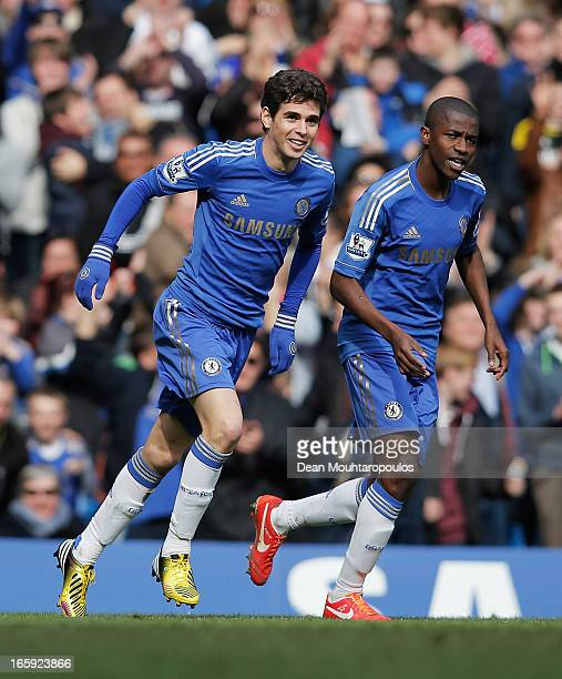 Oscar and Ramires of Chelsea celebrate the equalising goal an own goal by Matthew Kilgallon of Sunderland during the Barclays Premier League match...