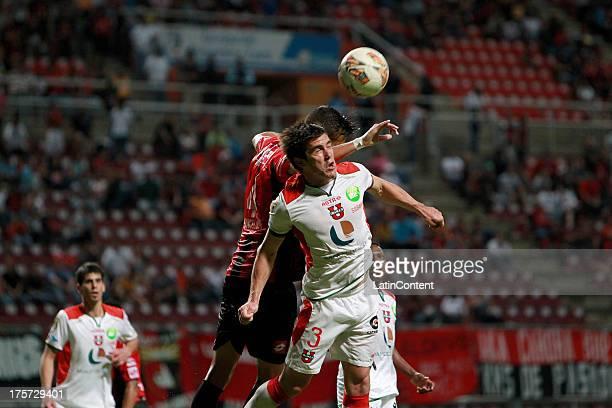 Oscar Ayala of Liga de Loja jumps for a header during a match between Deportivo Lara and Liga de la Loja as part of the Copa Total Sudamerican at...
