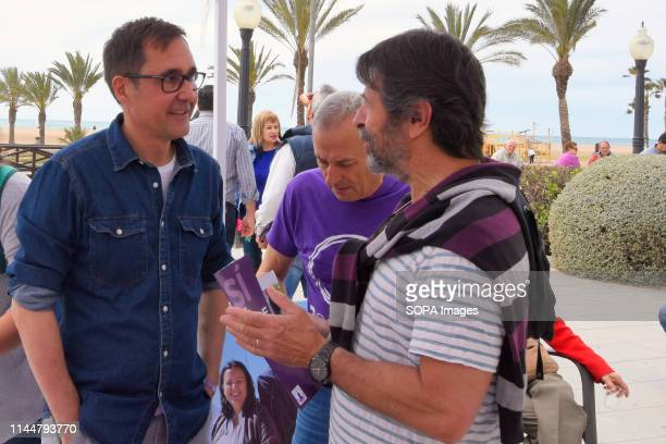 EL VENDRELL TARRAGONA SPAIN Oscar Blasco candidate from the political group Podemos for the mayor of El Vendrell Tarragona Spain seen talking with a...