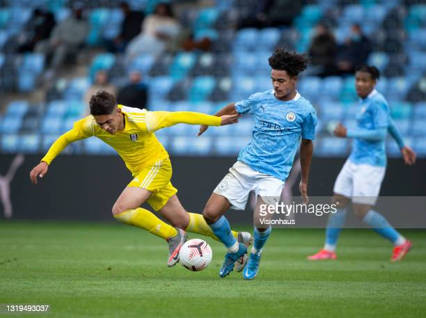 Oscar Bobb of Manchester City and Matt Dibley-Dias of Fulham in action during the U18 Premier League match between Manchester City and Fulham at The...