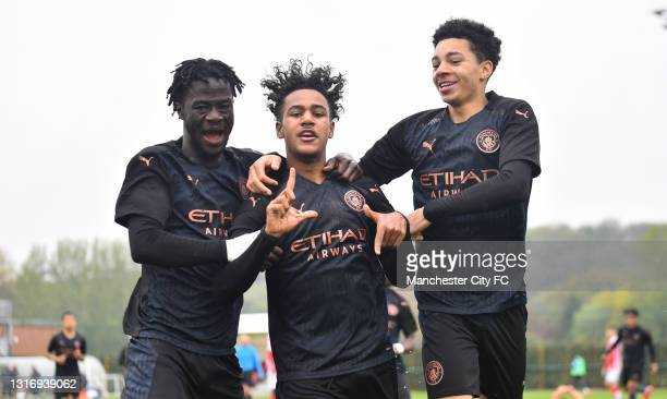 Oscar Bobb of Manchester City celebrates with his teammate as he scores their third goal during the U18 Premier League match between Stoke City and...