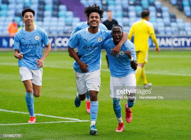 Oscar Bobb of Manchester City celebrates with teammates after scoring his teams third goal during the U18 Premier League Final match between...