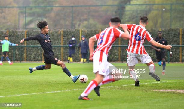 Oscar Bobb of Manchester City scores their third goal during the U18 Premier League match between Stoke City and Manchester City at Clayton Wood...