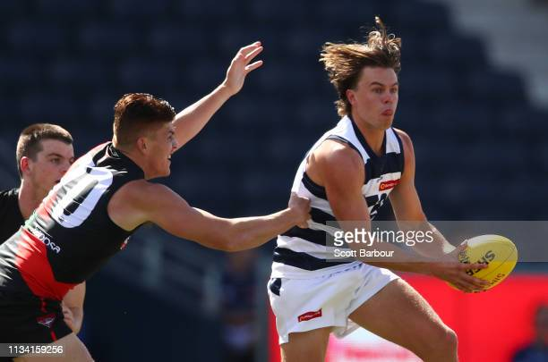 Oscar Brownless of the Geelong Cats runs with the ball during the VFL pre-Season match between the Geelong Cats and the Essendon Bombers at GMHBA...