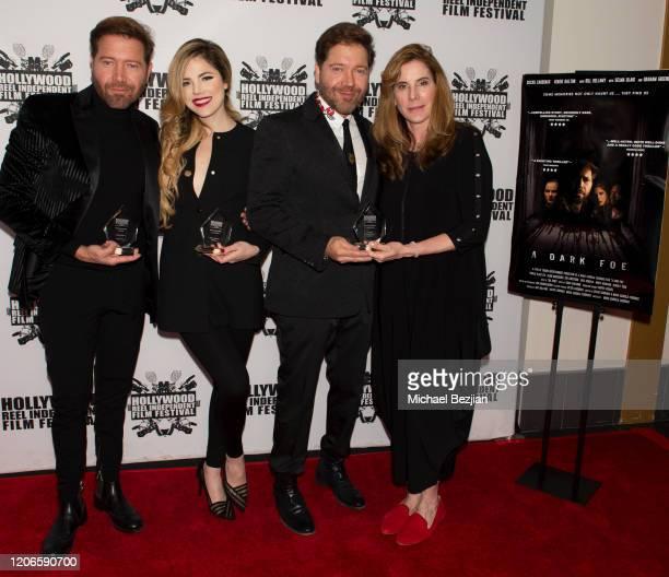 Oscar Cardenas Maria Gabriela Cardenas Victor Cardenas and Amy Williams arrive at A Dark Foe Film Premiere on February 15 2020 in Los Angeles...