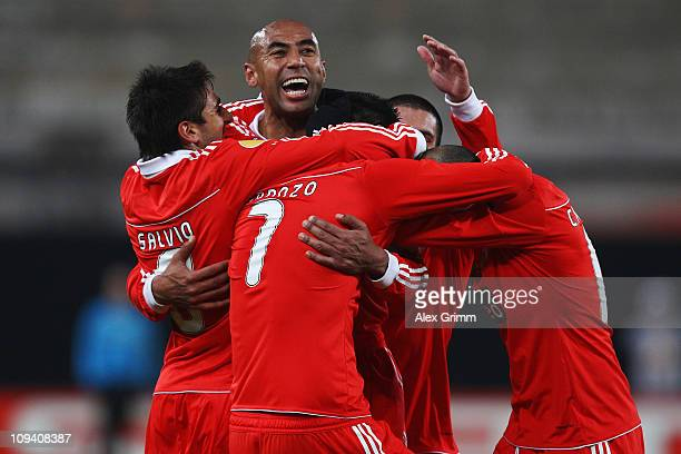 Oscar Cardozo of Benfica celebrates his team's second goal with team mates during the UEFA Europa League match round of 32 second leg between VfB...